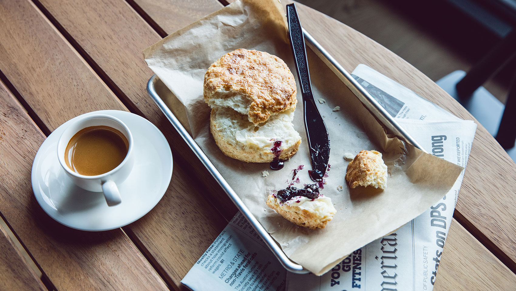 a pastry muffin with coffee on a wooden table