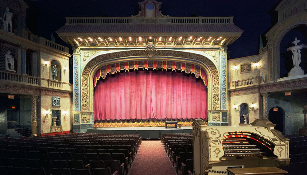 a performing arts theater with seats and a stage