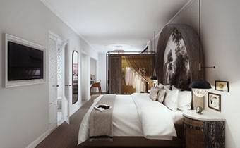 king bed with armoire and a painting on the wall